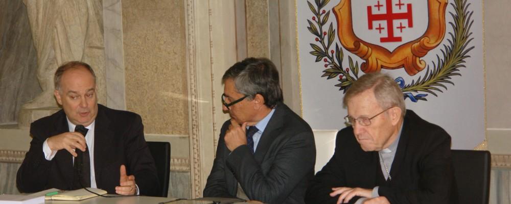 """Riccardo Burigana (a sinistra) presenta il volume """"Un cuore solo"""" insieme al giornalista Lucio Brunelli e al cardinale Walter Kasper"""